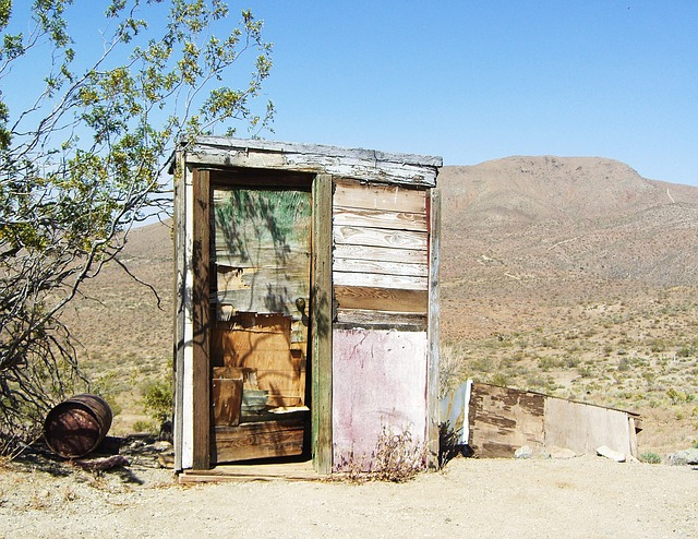 old desert outhouse